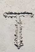 Sand beach alphabet: letter T — Stock Photo
