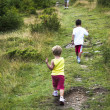 Children walking in mountain — Stock Photo