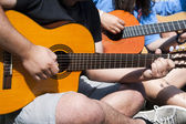 Young playing guitar together — Stock Photo