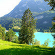 Blue mountain lake in a deep mountain valley — Stock Photo