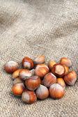 Hazelnuts on sacking background — Stock Photo