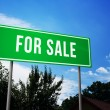 For Sale on Green Road Sign — Stock Photo