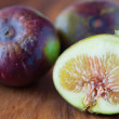 Stock Photo: Figs on wooden plate
