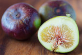 Figs on wooden plate — Stock Photo
