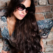 Long hair and sunglasses — Stock Photo
