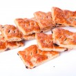 Cookies from flaky pastry with raisin on white background — 图库照片 #10916062