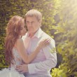 Wedding photo of the groom and the bride in park — Stock Photo #11168891