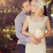 Stock Photo: Wedding kissing pair in park