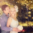Wedding photo of the groom and the bride in park — Stock Photo #11169014