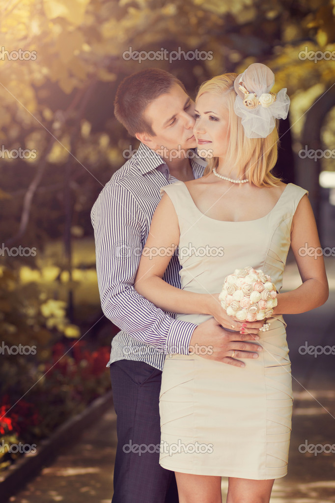 Photo of wedding kissing pair in park — Stock Photo #11168927