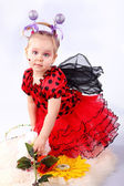 The little girl in a suit ladybirds with colors on a white backg — Stock Photo