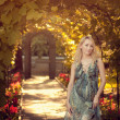 Стоковое фото: Beautiful pregnant girl in summer dress in sunset
