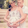 A loving couple expecting a baby in the park — Stok fotoğraf