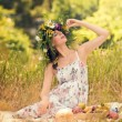 Stockfoto: Pregnant women in dry grass with ripe fruit