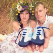 Couple in love during pregnancy in park with young Sneaker — Foto Stock #11642102