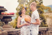 A couple in love during pregnancy in the park with fruits — Stock Photo