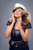 A beautiful woman dressed in a nautical style with the hair emit — Stock Photo