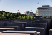 Holocaust Memorial in Berlin with American Embassy and Reichstag — Stock Photo