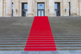 Red carpet on steps — Stock Photo