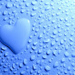 Water drops and heart shape on blue background — Stock Photo
