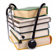 Royalty-Free Stock Photo: Pile of old books and stethoscope