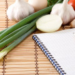 Royalty-Free Stock Photo: Notebook with pencil, garlic, tomato and onion