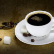 Cup of coffee and beans on wood — Stock Photo