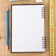 Notebook, school and office accessories on wood — Stock Photo