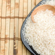 Rice and wood plate with spoon - Foto Stock