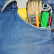 Tools in old blue jeans pocket — Stock Photo #10752973