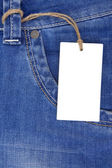 Price tag label over blue jeans texture — Stok fotoğraf