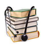 Pile of old books and stethoscope — Stockfoto