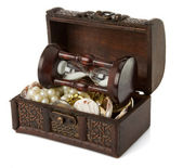 Chest with coins and jewels on white — Stock Photo