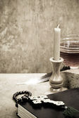 Holy Scriptures, candle and vine — Stock Photo