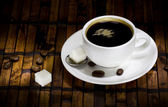 Cup of coffee ans beans — Stock Photo