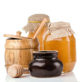 Glass, ceramic and wooden jars full of honey — Stock Photo