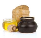Jars and pot of honey isolated on white — Stock Photo