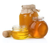 Glass jar and pot of honey with stick — Stock Photo