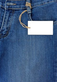 Price tag over jeans textured pocket — Photo