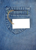 Price tag label over blue jeans texture — Stock Photo