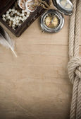 Ship ropes and compass on wood — Stock Photo