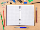 School accessories and notebook on wood — Stock Photo