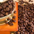 Coffee grinder on beans - Stock Photo