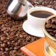 Cup of coffee and beans — Stock Photo