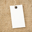 Price tag and sack burlap background - Foto de Stock  