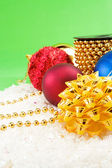 Christmas decoration with snow on green — Stock Photo