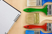Colorful paintbrush on wood — Stockfoto