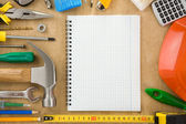 Construction tools and notebook — Stock Photo