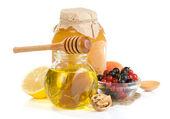 Glass jar full of honey — Stock Photo