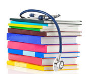 Stethoscope and pile of books — Stock Photo
